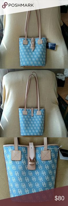 """DOONEY & BOURKE Bucket Bag. NWT. NWT, EMBROIDERED, DENIM BLUE & CREAM Dooney & Bourke INITIAL BUCKET BAG. Coated canvas with vachetta leather trim. 10"""" High,  Bottom is 8.25"""" Length,  Length across top 10.25"""",  13.5""""  Drop, Vachetta Leather Double Shoulder Straps. Dooney & Bourke Bags Shoulder Bags"""