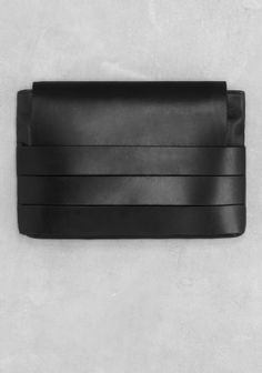 A clutch that stylishly plays with both soft and stiff leather to create a chic and daring design.