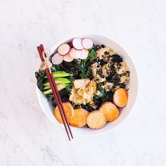 """For the cold that is not-so-slowly greeting us these days, APL loves to """"winterize"""" our salads by adding some warmth to them for comfort AND nutrition. This well-balanced bowl is perfect for an easy go-to lunch all season long and by combining seriously nutritious foods like avocado, sweet potato, kimchi, sprouted brown rice, wakame seaweed, kale, + radishes topped with a gluten-free teriyaki sauce + heart-healthy hemp seeds…this is a GEM for your inner and outer beauty and health. For the…"""