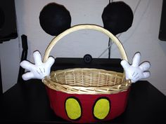 Mickey Mouse Easter basket. Hand sewn gloves & ears, also used hot glue and wires. Took less than 2 days. Not bad for my first sewing project!