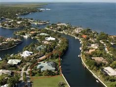 Elegant canal front home at Ocean Reef with just over 226 feet of water frontage and expansive water views. With 4,060 square feet of living space, this gracious and well designed home features 4 generous bedrooms with en suite baths plus powder room and two-car garage. Graceful columns and dramatic arched entry and windows beckon into the great room with 17 foot ceiling and custom built-ins surrounding the fireplace.