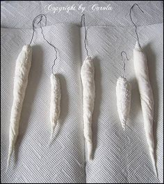 Spun cotton icicles Ha........look just like the papier mache ones.  Pretty doggone simple to make