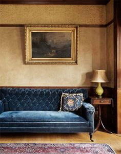 For Old World style, the palette is deep, rich and regal but muted for a timeworn effect. Rich fabrics, like this velvet sofa, are key. #OldWorld
