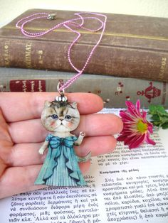 Check out this item in my Etsy shop https://www.etsy.com/listing/211823503/cat-pendant-cat-necklace-wooden-pendant