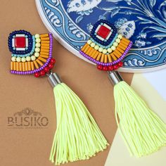 Stylish colorful tassels earrings Beaded embroidered ethnic pattern earring Orange blue red earring with yellow tassel African women fashion by BusikoUA on Etsy