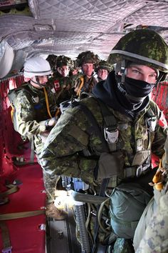 Paratroopers from 3rd Battalion, Royal Canadian Regiment aboard CH-147 conduct jump training jumps in November 2017.