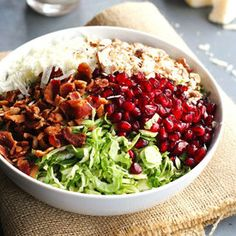 This chopped brussels sprout salad has pomegranates, almonds, crumbled bacon, and homemade creamy salad dressing. Perfect for a healthy holiday dish! Sprouts Salad, Brussel Sprout Salad, Brussels Sprouts, Creamy Salad Dressing, Honey Dressing, Queso Fresco, Cooking Recipes, Healthy Recipes, Recipes