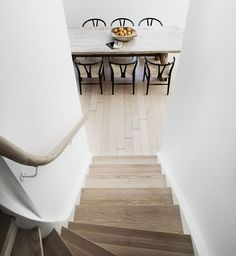 An inviting view from the staircase: CH24 Wishbone Chairs designed by Hans J. Wegner for Carl Hansen & Søn.