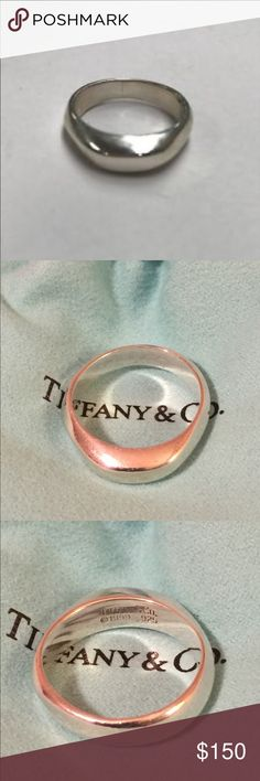 Tiffany & Co Twisted Done Ring Authentic Tiffany sterling silver Twisted Dome Ring stamped and dated 1999. Normal wear. Has been kept in its bag. No tarnish. EUC. Dust bag included. Wore it on my middle finger. Thin enough for stacking. Ring size is 8. Tiffany & Co. Jewelry Rings