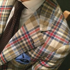 agnelli-esque:  source: bntailor - Just don't like the look of a tie worn with a Madras jacket !