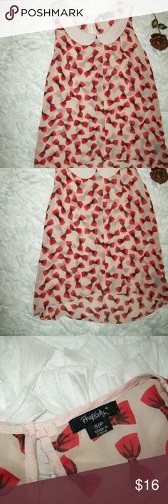 Pink With Red Bows Peter Pan Collar Sheer Blouse Rhapsody Pink With Red Bows Peter Pan Collar Semi Sheer Blouse Size S/P. Item is in great shape with no hole or stains. Keyhole button at the back and high low hem. See pictures for details and measurements. Check out my store for more items. Will consider all offers! Rhapsody Tops Blouses