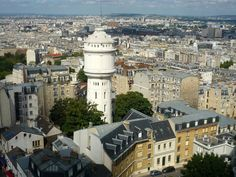 Water Tower of Montmartre - Situated in the rue du Mont Cenis not far from the Sacré-Cœur stands the tall Water Tower of Montmartre, built in 1927 with the same white stone of the basilica Hidden Places, Places To Go, Montmartre Paris, I Love Paris, Water Tower, White Stone, Nice View, Paris Skyline, Photos