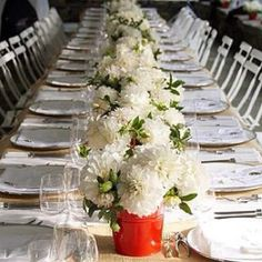 Long, running white dahlia centerpiece made up of many small metal buckets.  So cute !!