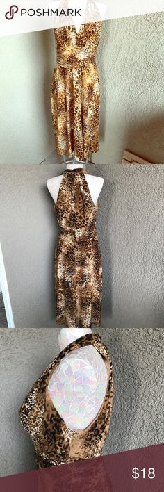 Evan Picone Animal Print Dress Pre-owned in good condition no flaws Evan Picone animal print dress. Sleeveless, ruched waist, v neckline. Slips over head. measures 40 inches long. The fabric is polyester and spandex. Evan Picone Dresses