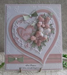"""Good morning friends and visitors.My card today using this pretty """"Rose Heart"""" by Yvonne Creations. This Rose Heart shape cuts out and leaves the negative behind..I cut a Tattered Lace.. Pin Dot Hea"""