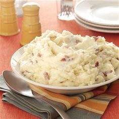 Garlic Mashed Red Potatoes Recipe -These creamy garlic mashed potatoes are so good, you can serve them plain—no butter or gravy is needed. This is the only way we prepare mashed potatoes. —Valerie Mitchell, Olathe, Kansas
