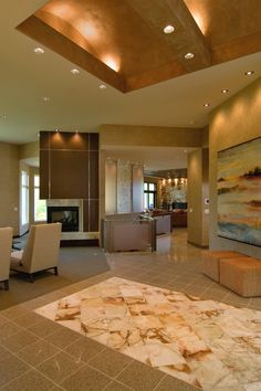 Amazing foyer with decorative tile, ceiling and stunning three-way fireplace - plan 013S-0011 - houseplansandmore.com