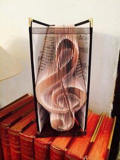 "Buchfalten - Violinschlüssel Book Folding Pattern for ""Treble clef"" Folded Book Art, Paper Book, Paper Art, Paper Crafts, Cut Paper, Beginner Sewing Patterns, Book Page Crafts, Recycled Books, Book Sculpture"