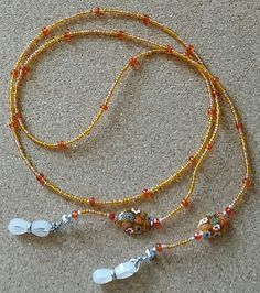 Check out this item in my Etsy shop https://www.etsy.com/listing/495712452/eye-glasses-chain-orange-crystal-glasses