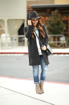 gray coat with jeans and fedora hat