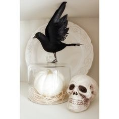 This one is so simple but stunning. Re-create the look by styling a white plate, white skull, and white pumpkin together. Then, top off the look with a perfectly perched crow.