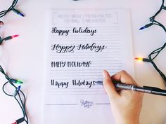"""Practice lettering with a free holiday lettering worksheet! This holiday lettering worksheet helps you learn to handletter """"happy holidays"""" in 4 styles. Calligraphy Letters, Modern Calligraphy, Caligraphy, Tombow, Brush Lettering, Brush Pen, Holiday Crafts, Typography, Paper Crafts"""