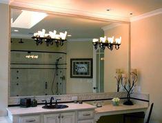 Holes cut in bath vanity mirror for light fixtures. Bathroom Chandelier, Beveled Mirror, Bath Vanities, Shower Doors, Master Bathroom, Light Fixtures, Vanity, Lighting, Baths