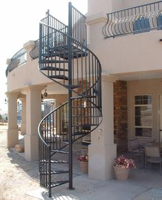 Best Spiral Staircase Design Ideas That Would Beautify Your Home Generally when we plan for home renovation, we do not keep attention on staircases but we must do. Here are some spiral staircase design for your home to make it look modern. Spiral Staircase For Sale, Spiral Staircase Outdoor, Spiral Stairs Design, Stair Railing Design, Outdoor Stairs, Staircase Design Modern, Spiral Staircases, Wrought Iron Stair Railing, Iron Staircase