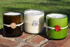 Recycled wine bottle candles, with wax seal - favor idea
