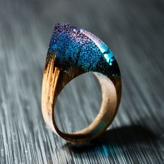 Enchanting Resin Rings That Hold The Northern Lights Beautiful - Inside each of these wooden rings is a beautiful hidden world