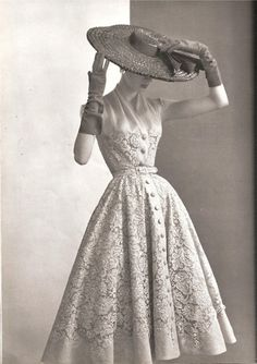 """Pierre Balmain, 1950 - 1950's dress styles gained popularity with the creation of Dior's postwar """"New Look"""" in 1947."""