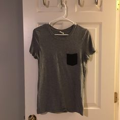 Victoria's Secret PINK Pocket Tee Grey tee with black pocket from Victoria's Secret PINK. No flaws. Worn several times. Great condition. PINK Victoria's Secret Tops Tees - Short Sleeve