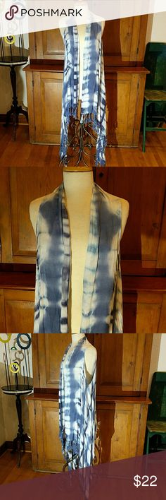 Tie-Dye Long Fringed Vest Super Popular right now a long vest is a Wardrobe Must Have! This one is definitely an attention getter. Wonderful over a dress and perfect to wear with denim, leggings or pants -- even shorts. Grown-up tie-dye in Pretty Periwinkle Blue.  100% Rayon New ONE WORLD Tops