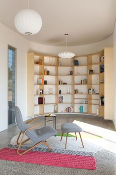 In the curved wall of the Southern Highlands House a custom plywood bookshelf fits perfectly