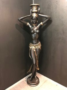 Buy A LARGE MID CENTURY 1950 LIFE SIZE BRONZE COLD PAINTED FIGURINE OF AFRICAN LADYfor R24,500.00