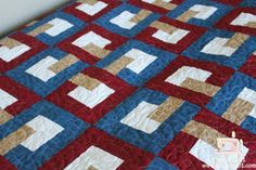 I like the way the tan square interlocks the blue & the red squares for a woven look