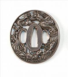 "SILVER NAGA MARU-GATA TSUBA 18th/19th Century With openwork design of dragons and waves. Signed ""Omori Teruhide"". Length 2.75"" (7.2 cm)."