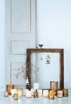 brown rustic frame with white and gold candle holders for Christmas decor