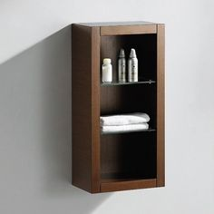 "Wenge Brown Bathroom Linen Side Cabinet w/ 2 Glass Shelves https://www.studio9furniture.com/bathroom/linen-cabinets/fresca-wenge-brown-bathroom-linen-side-cabinet-w-2-glass-shelves  Made from a plywood with veneer, this linen cabinet is a perfect match for all Fresca Allier ""Gray Oak"" vanities."