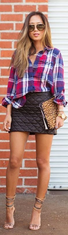 Plaid shirt mixed with quilted black leather skirt and strappy heels.  Love this mixed up look.