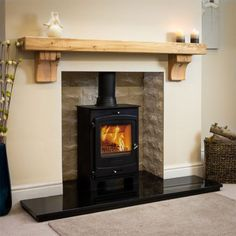 The rustic square oak beam mantel shelf showcases a beautiful chunky, rustic appearance with hand-scalloped edges for a truly traditional style. Wood Burner Fireplace, Oak Mantle, Wooden Mantle, Fireplace Shelves, Mantel Shelf, Cosy Fireplace, Log Burner Living Room, Living Room Decor Fireplace, Fireplace Design