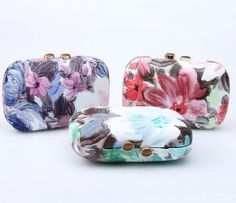 Commodity:LML001 Alibaba China 2016 New Women Flower Pattern Oval Evening Clutch Bag Color:Blue-green,Purple-red,Red-black Size:16cm*5cm*10cm Function:Handbag,clutch bag,shoulder bag Weight:0.5KG Chain:120CM