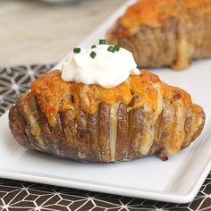 scalloped hasselback potatoes - take regular hasselback potatoes to a whole new level: slice potatoes are stuffed with cheese & butter, and then baked. Afterwards, they are covered with cream and more cheese, and returned to the oven... YES!