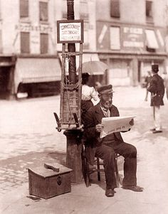 Photographer: Eugene Atget. This photographer lived between 1857-1927...I love this photo of a French shoe polisher. There's another photo by this photographer of Sacre Couer that's really interesting too because I recently walked on the street it was taken.