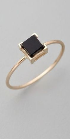 black and gold ring, love.  Simple square cut diamond and minimal thin band.
