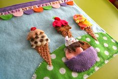 I've been quiet here, but busy busy busy! This week has been work, time with Jax and sewing the latest addition to Jax's vacation quiet book: an ice cream parlor! (If you are a fan of the Facebook ...