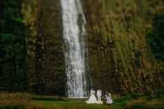 """A BIG congratulations to Masashi & Ayaka who took to the skies to say """"I Do""""! They had a gorgeous and intimate helicopter wedding on the Big Island of Hawaii and had their ceremony take place at a majestic, remote waterfall! The views were breathtaking and so were the couple! Mahalo to Bikini Birdie who captured the amazing photos and to Steven Cook of A White Orchid Wedding for being their fearless planner! Congrats again from all of us at WOW!"""