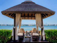 Sofitel Dubai The Palm Resort and Spa, Palm Jumeirah, allow clients to escape the stress of the concrete jungle and relax in a natural paradise. Outdoor Gazebos, Outdoor Spaces, Outdoor Structures, Palm Resort, Resort Spa, Sofitel Hotel, Palm Jumeirah, Luxury Kitchen Design, Thatched Roof