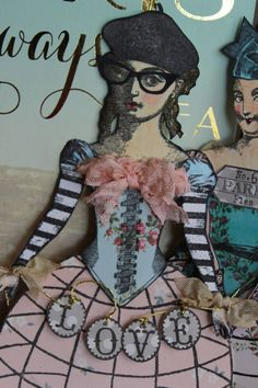 Paper doll constructed with the Paris Flea collection of art stamps from Character Constructions.