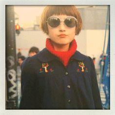 Pillarbox turtleneck. Chunky knit. navy overcoat. Round sunglasses. cool.